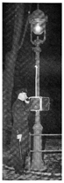 Police Officer Standing by Pole with Call Box
